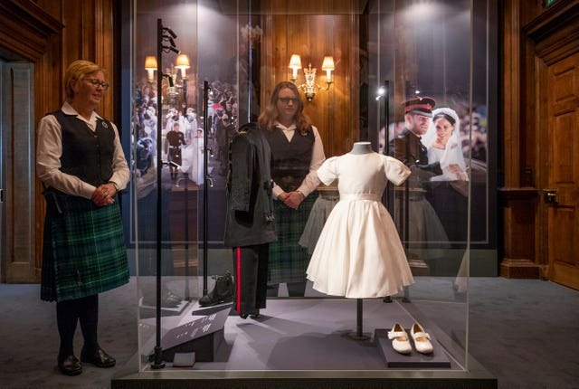 The wedding outfits worn by Prince George and Princess Charlotte in an exhibition at the Palace of Holyroodhouse, Edinburgh