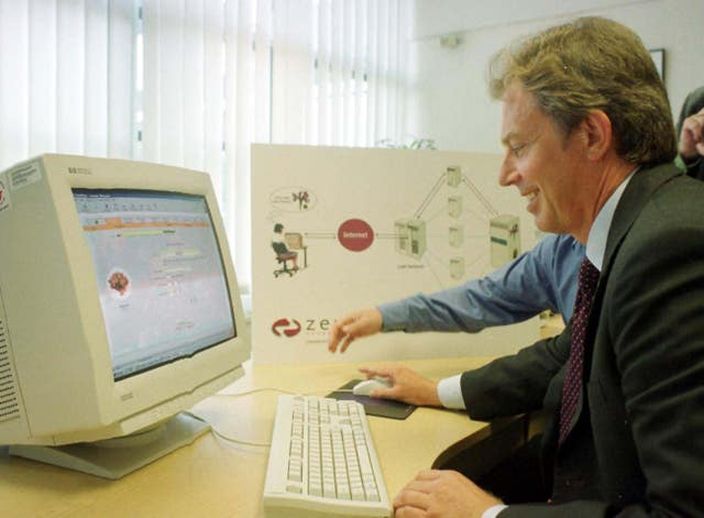 Tony Blair using the internet to send his wife a bunch of flowers (Michael Stephens/PA)