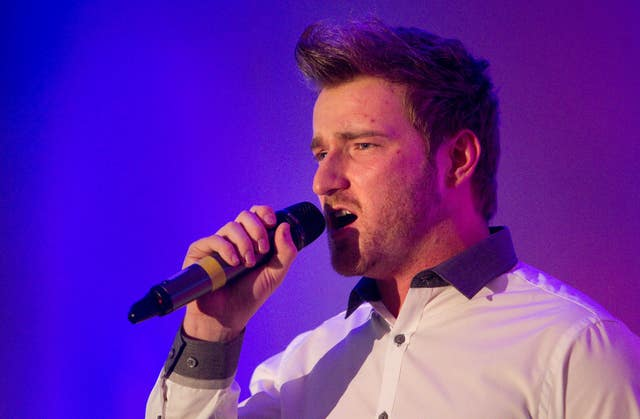 Jai McDowall singing at Help a Capital Child Burns night at the Marriott Grosvenor Square, London