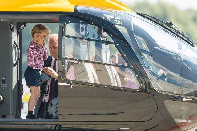 Prince George inside a rescue helicopter during a visit to Airbus in Hamburg on a royal visit to Germany