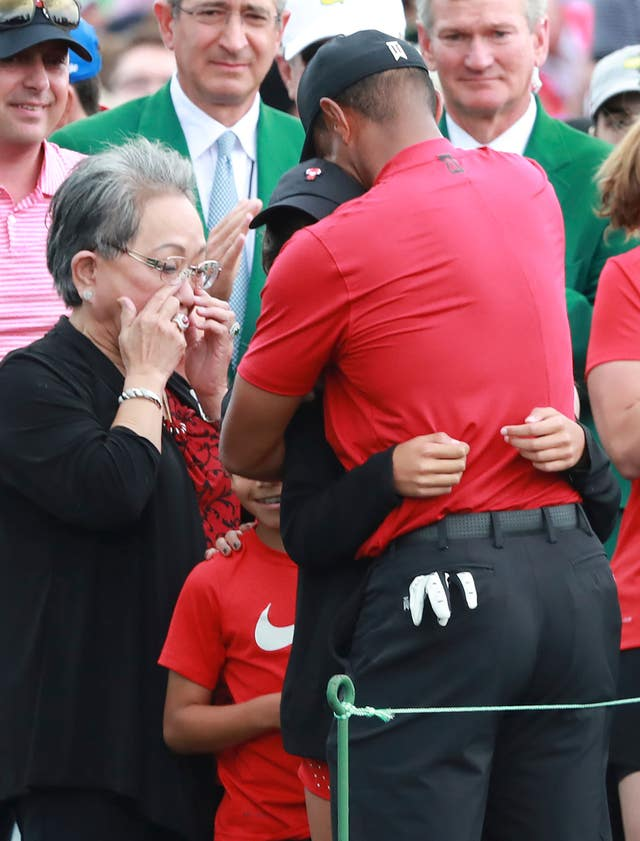 Kultida Woods (L) reacts to son Tiger's Masters triumph