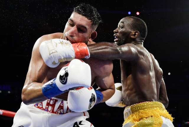 Amir Khan had taken heavy punishment from Terence Crawford