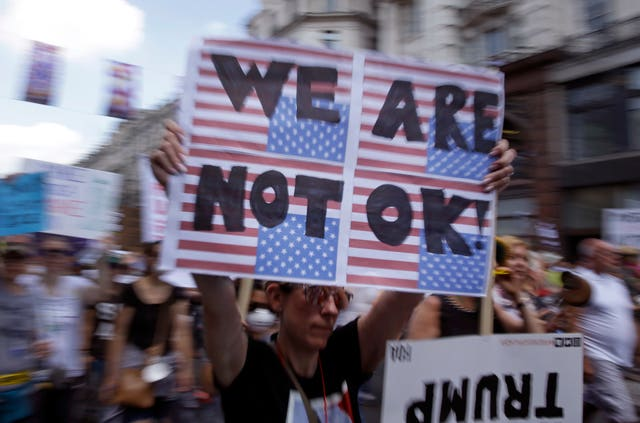 Placard reads 'we are not OK' during Trump protest in London