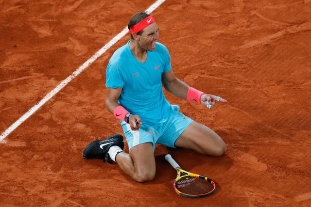 Rafael Nadal collapses to the ground after winning his 13th French Open