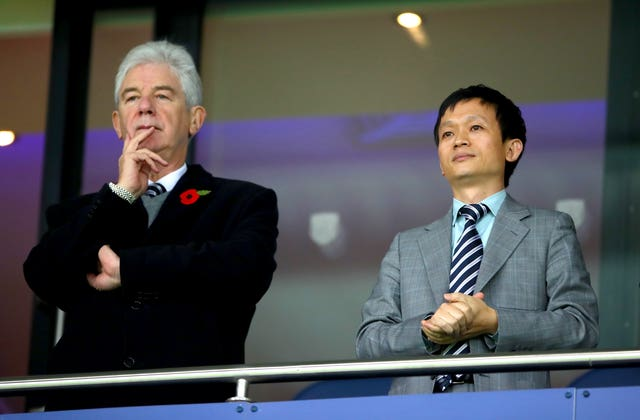 Club owner Guochuan Lai, pictured right, has terminated the contract of John Williams