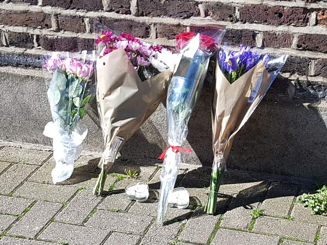 Flowers at the scene in Link Street and Morning Lane, Hackney, east London after a man in his 20s died after being stabbed (Tess de la Mare/PA)