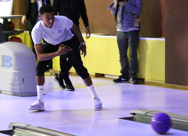Jesse Lingard was one of several England players to show off their skills on the lanes as they bowled in the media centre in Repino