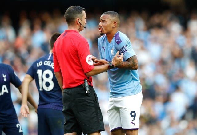 Gabriel Jesus pleads with referee Michael Oliver, left