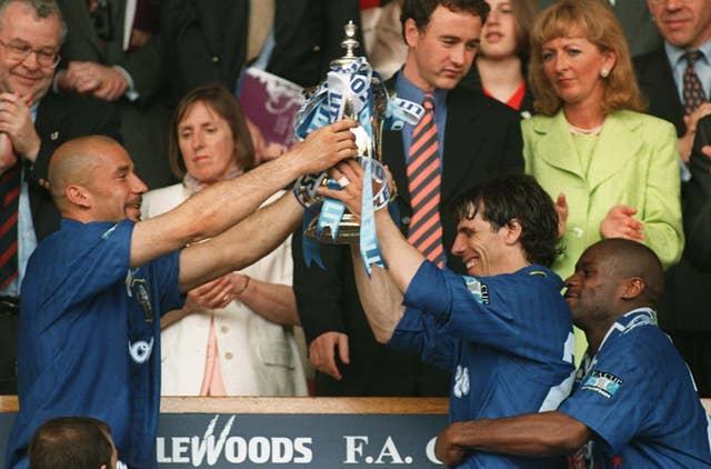 Gianluca Vialli, left, and Gianfranco Zola hold the trophy aloft after Chelsea beat Middlesbrough in the 1997 final