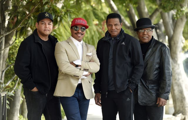 Marlon Jackson, second from left, Jackie Jackson, second from right, and Tito Jackson, far right, brothers of the late singer Michael Jackson, and Tito's son Taj, far left