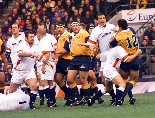 England's Martin Johnson (right) comes to blows with Australia's Nathan Gray as their respective teams meet at Twickenham in 1998