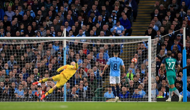 Ederson dives to his left but cannot deny Son Spurs' second to make it 3-1 on aggregate