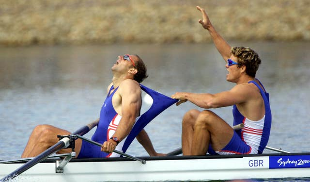 Redgrave, left, wins gold in the coxless fours at the Sydney Olympics