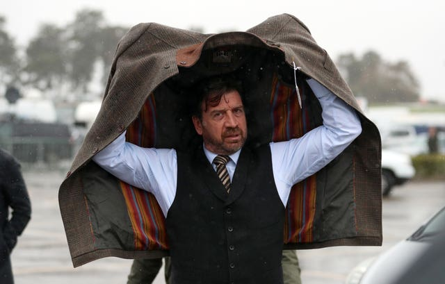 Celebrity Nick Knowles just about managed to keep dry on arrival