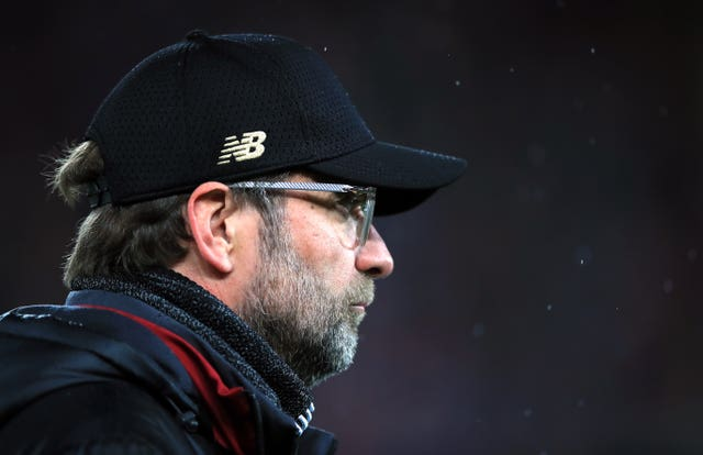 Jurgen Klopp's Liverpool are at Fulham on Sunday (Peter Byrne/PA).