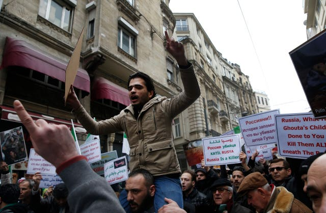 Protests take place outside the Russian Consulate in Istanbul (AP)