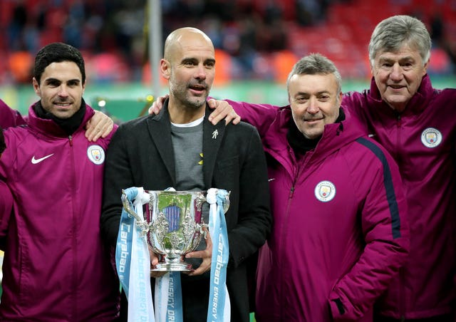 Arteta (left) helped Manchester City win the Premier League and Carabao Cup this season