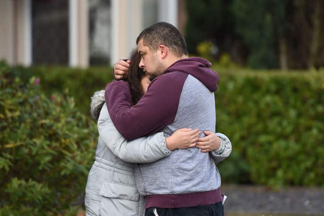 Reece Platt-May, the father of brothers Corey and Casper, hugs his sister Tia Fletcher close to the scene where the boys were killed in a hit-and-run collision (Joe Giddens/PA)