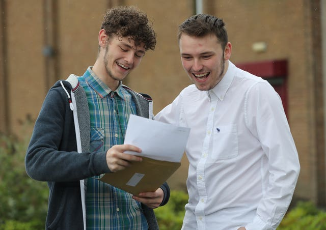 Cousins Tyler Crooks and Scott Chambers collect their results at Abbey Community College in Newtownabbey, Northern Ireland