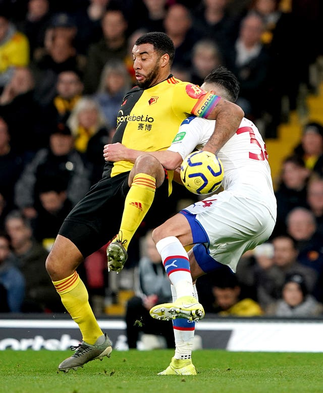 Watford's Troy Deeney got caught up with Crystal Palace's Martin Kelly during the 0-0 draw which was the Hornets' first home match since sacking Quique Sanchez Flores for a second time