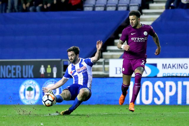Guardiola loses cool as Wigan dump Manchester City out of FA Cup