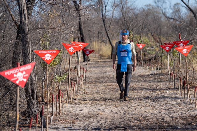 The Duke of Sussex walks through a minefield in Dirico, Angola, during a visit to see the work of landmine clearance charity the Halo Trust, on day five of the royal tour of Africa