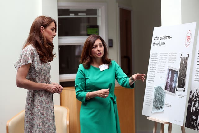 The Duchess of Cambridge during a visit to a Royal Photographic Society workshop with Action for Children