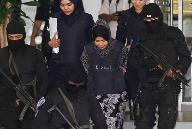 Indonesian Siti Aisyah, second from right, is escorted by police as she leaves court (AP Photo/Sadiq Asyraf)