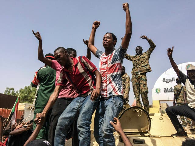 Sudanese celebrate after officials said the military had forced longtime autocratic President Omar al-Bashir to step down after 30 years in power