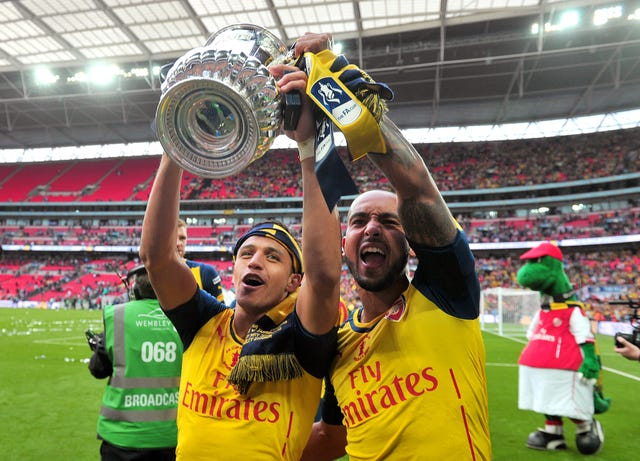 Sanchez (left) won the FA Cup twice with Arsenal