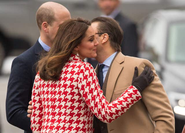 The Duke and Duchess of Cambridge greets Prince Daniel of Sweden as they arrive at the Karolinska Institute in Stockholm on Day 2 of the Duke and Duchess of Cambridge's visit to Sweden. (Dominic Lipinski/PA)