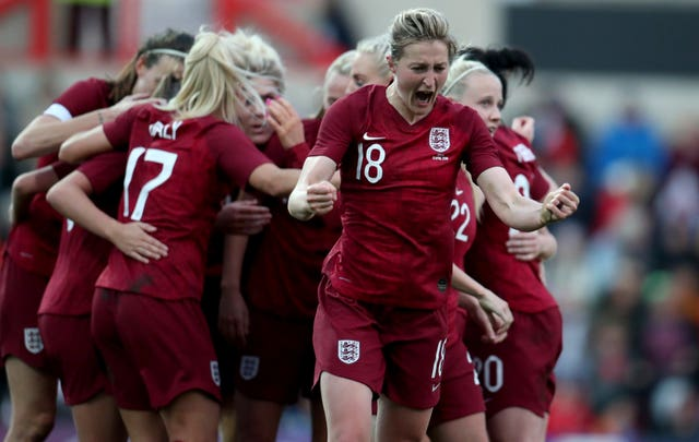 White celebrates after England go 1-0 up against Spain