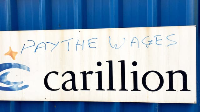 Graffiti at the site of the new £355m Royal Liverpool Hospital, which was being built by Carillion, as their construction workers will continue to be paid, while bonus payments to directors and former executives have been stopped.