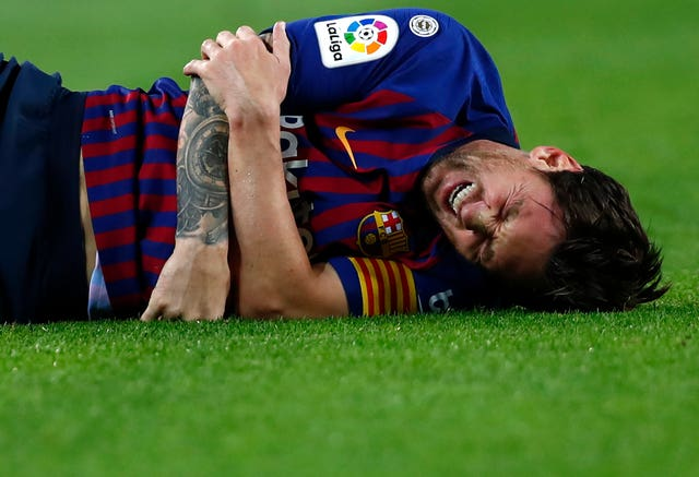 Lionel Messi fractured his right arm during Barcelona's victory over Seville
