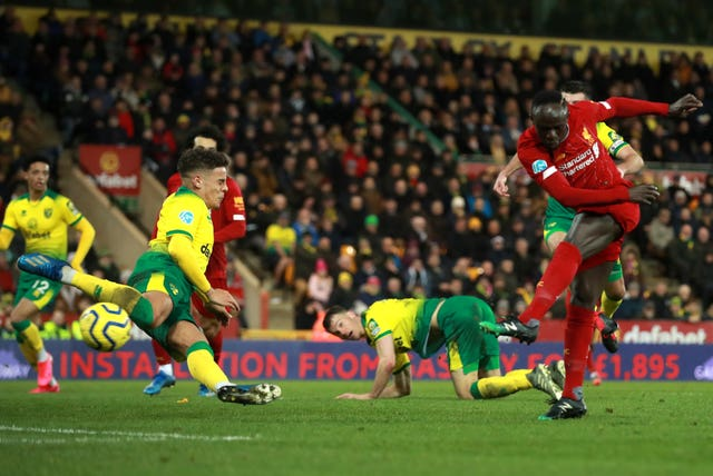 Sadio Mane, right, scores the winner at Norwich