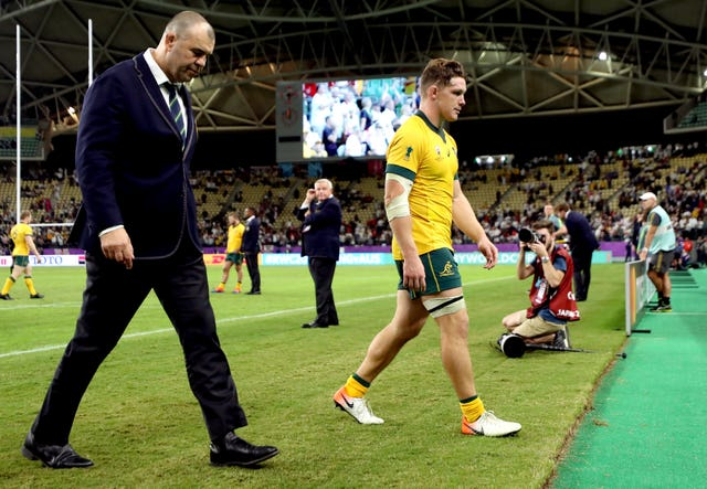 Cheika and Michael Hooper walk off the pitch dejected after defeat to England