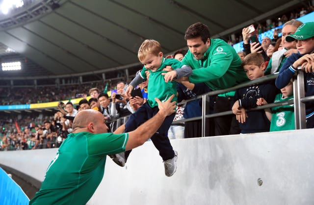 Rory Best lifts his son Richie from the stands after playing his final match for Ireland