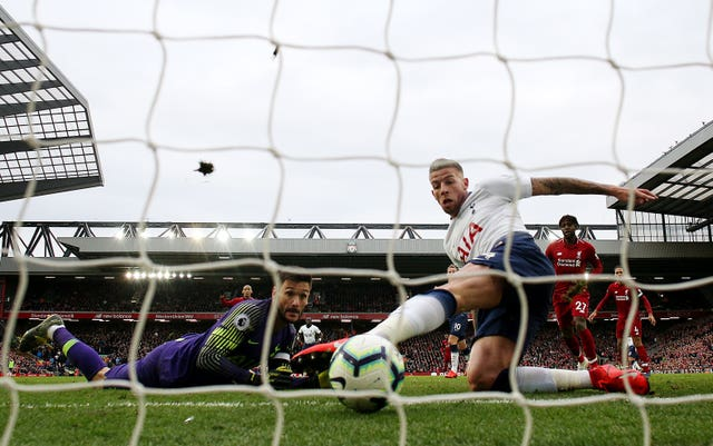 Toby Alderweireld, right, scores an unlucky own goal to hand Liverpool victory