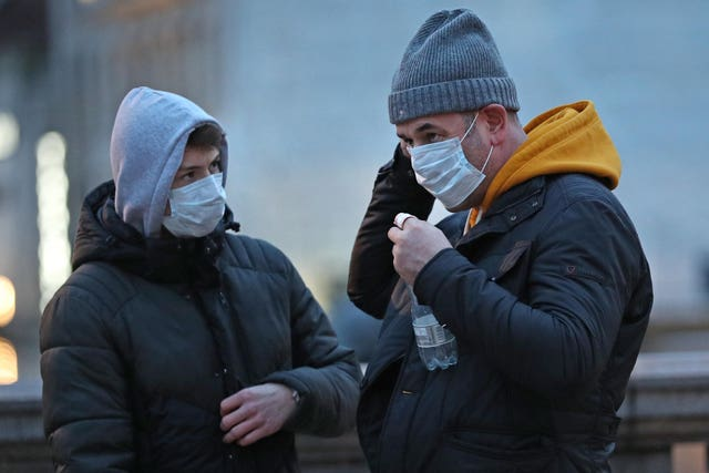 People wearing face masks in Trafalgar Square (Yui Mok/PA)