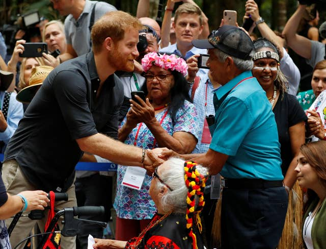 The Duke of Sussex greets people during a dedication ceremony of the forests of K'gari to the Queen's Commonwealth Canopy on Fraser Island (Phil Noble/PA)