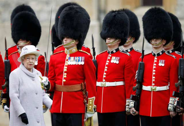 Queen presents colours to Coldstream Guards