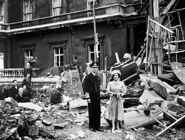 King George VI and the Queen Mother survey bomb damage at Buckingham Palace - care home residents told William and Kate about air attacks they had suffered. PA Wire