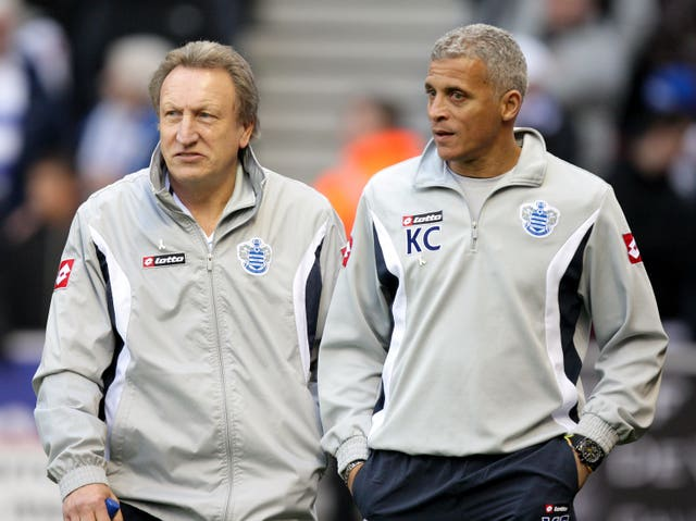 Curle (right) was working under Neil Warnock (left) when QPR won promotion in 2011