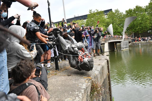 Protesters throw statue of Edward Colston into Bristol harbour (Ben Birchall/PA)