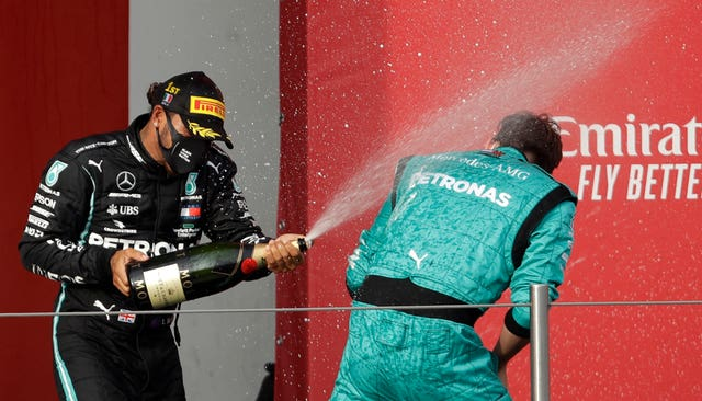 Lewis Hamilton, left, closed in on his record-equalling seventh world drivers' title with victory at the Emilia Romagna Grand Prix in Italy