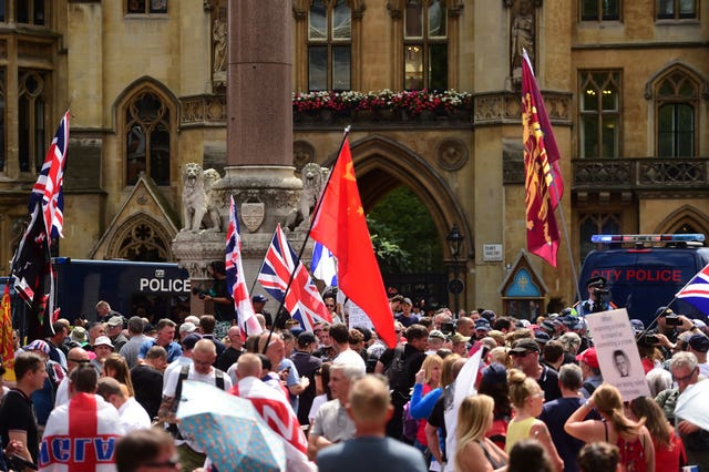 Tommy Robinson supporters in Westminster, London, after he was jailed for nine months for contempt of court