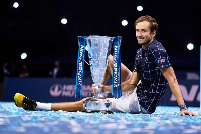 Daniil Medvedev poses with the ATP Finals trophy
