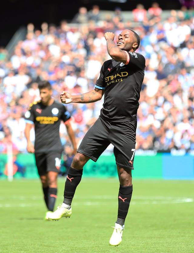 Sterling celebrates scoring City's third of the match