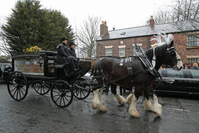 The funeral cortege carries Sir Ken Dodd's coffin from his home in Knotty Ash (Aaron Chown/PA)