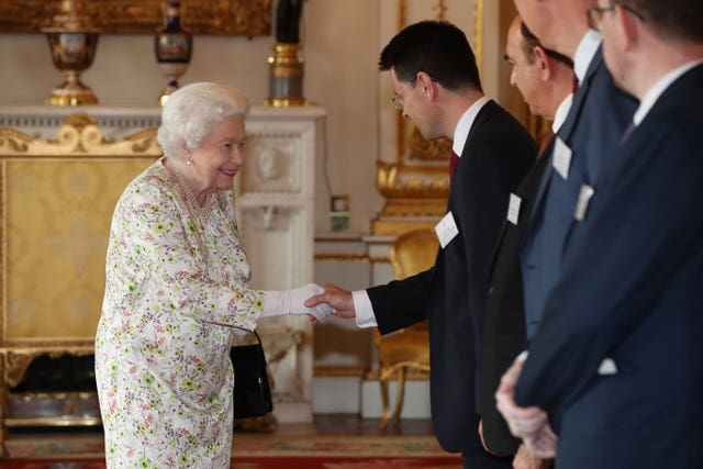 Queen Elizabeth II greets Housing Secretary James Brokenshire (Jonathan Brady/PA)